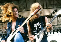 UNITED KINGDOM - JANUARY 01:  Photo of METALLICA and Cliff BURTON and James HETFIELD; Cliff Burton (playing Rickenbacker bass) and James Hetfield (playing Gibson Flying V guitar) performing live onstage,  (Photo by Pete Cronin/Redferns)