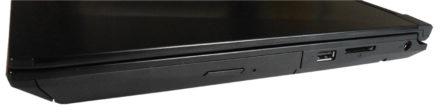 El otro lateral tiene la lectora de discos ópticos, puerto USB 2.0, lector de tarjetas SD y la entrada del cargador.